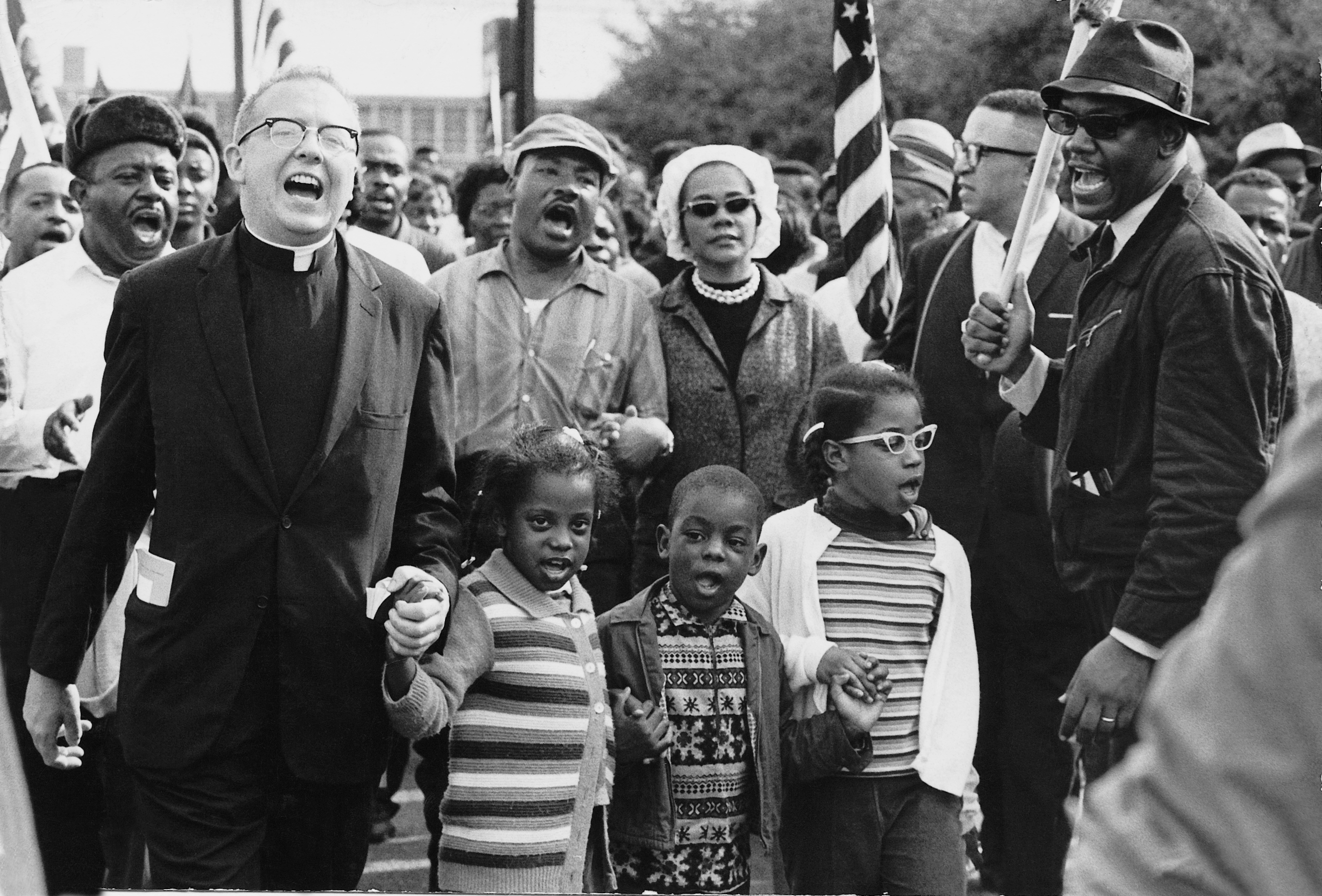 Photo of Rev. King, the Abernathy children and others marching to